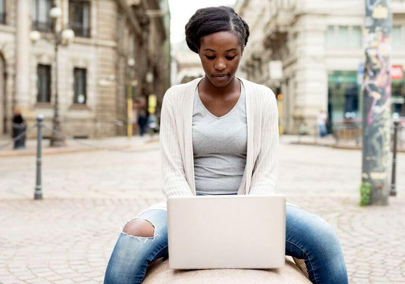 Black woman laptop solo female traveler RF
